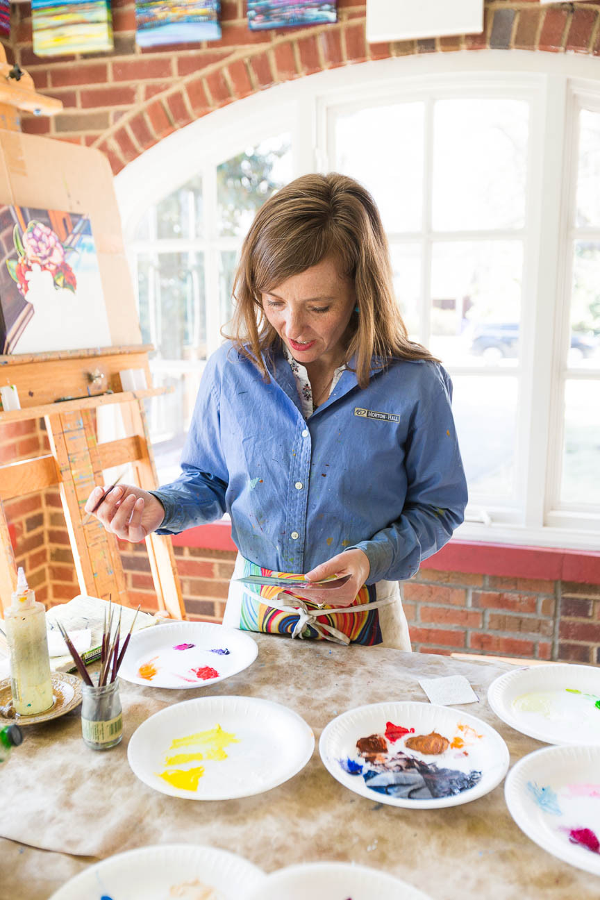 Marie Scott working on painting, Greenville SC artist