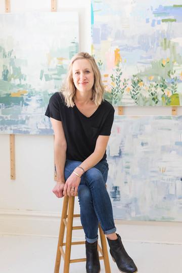 Portrait-of-artist-sittin-on-stool-in-Br