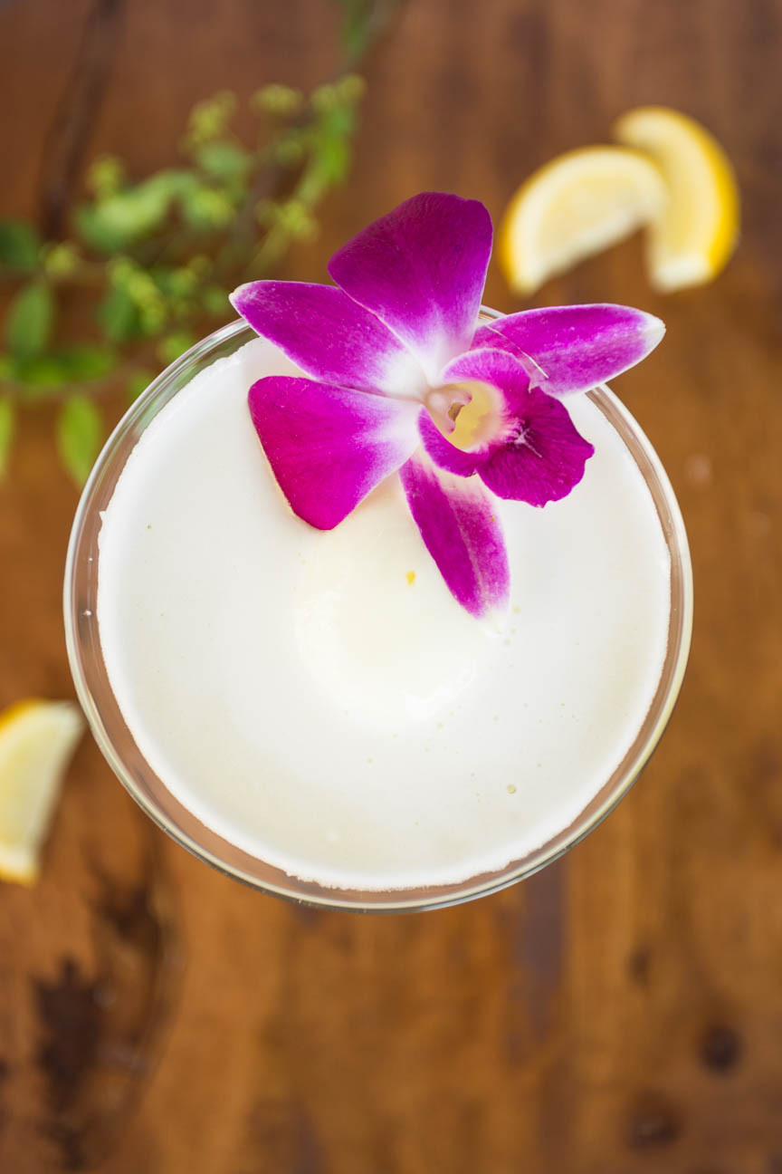 image of limoncello with purple orchid garnish