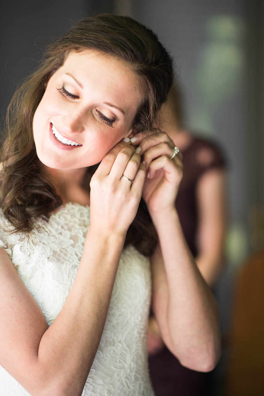 Katie puts in her bridal earrings before her ceremony