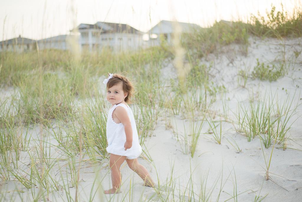 Little Girl Walks on Beach Image