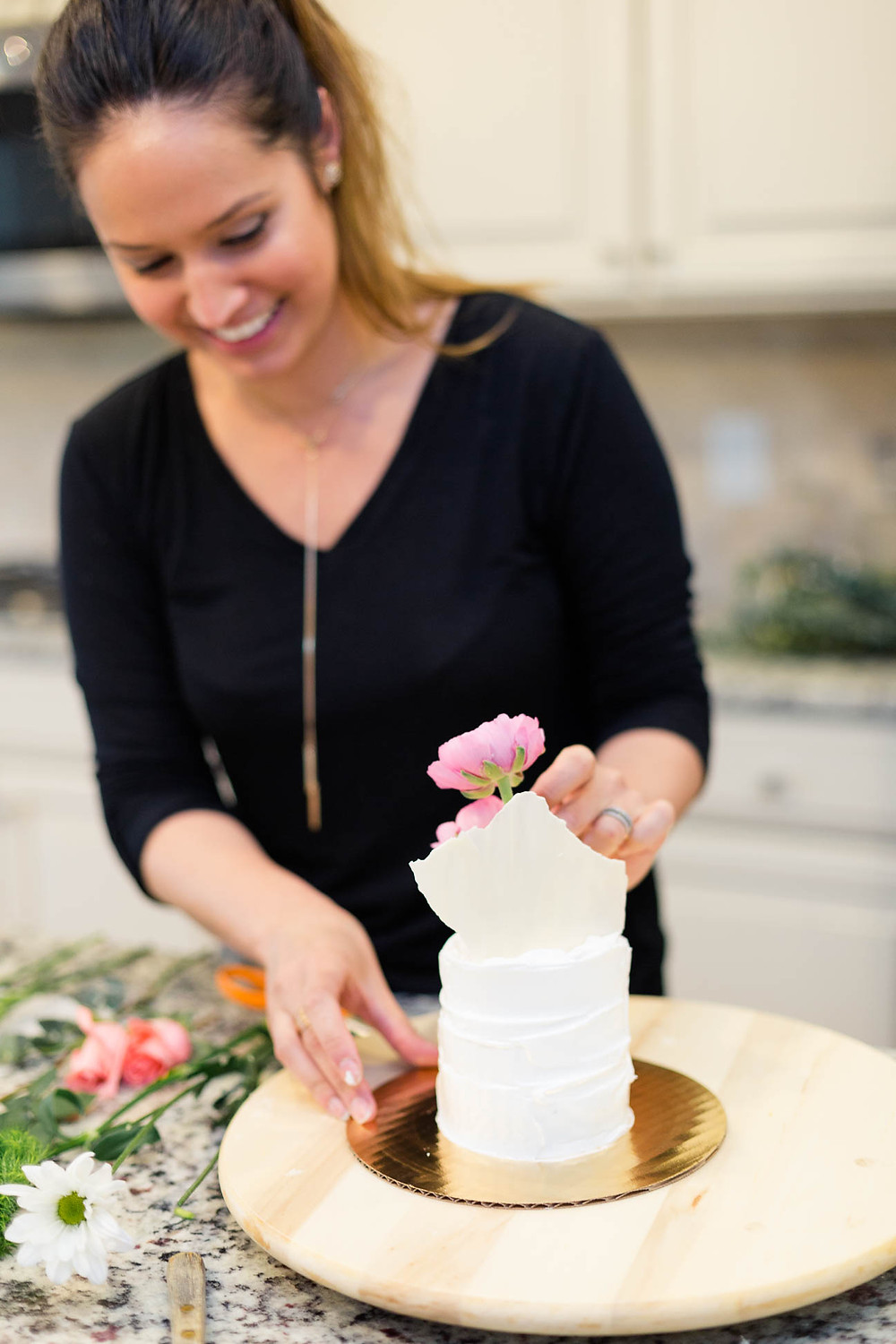 Michal decorates cakes with pink florals, ranunculus, floral inspired cakes, white chocolate sheet, s'mores cake