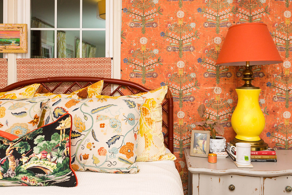 Image of Amanda Louise Interiors colorful bedroom with orange wallpaper by photographers in greenville sc