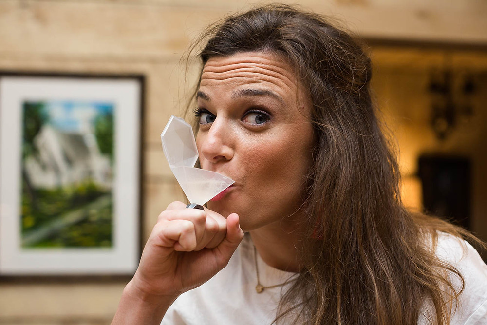 image of girl drinking from ring glass