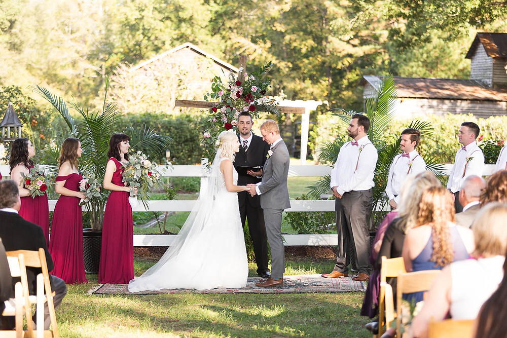 bride and groom say vows during farm wedding