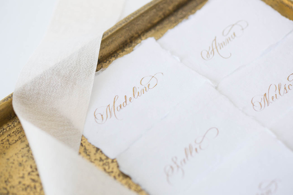 calligraphy place cards with gold ink