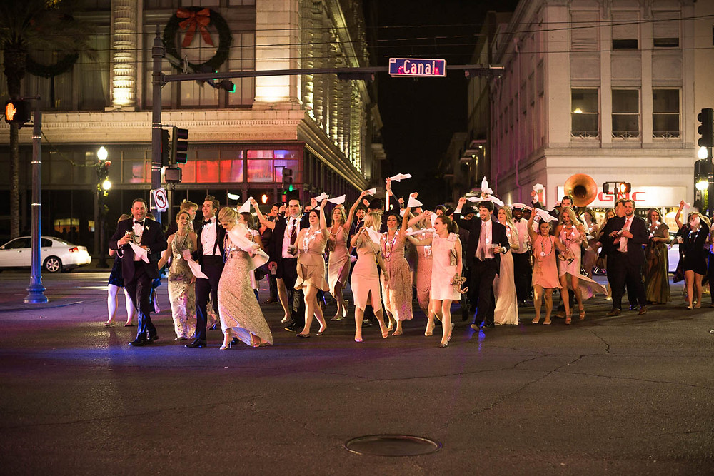 image of wedding guests in a second line in NOLA