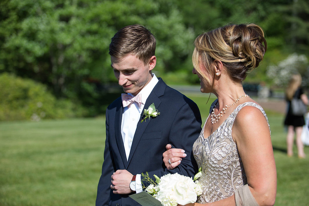 groom walks his mother down the aisle at Grandfather Golf and Country Club Wedding