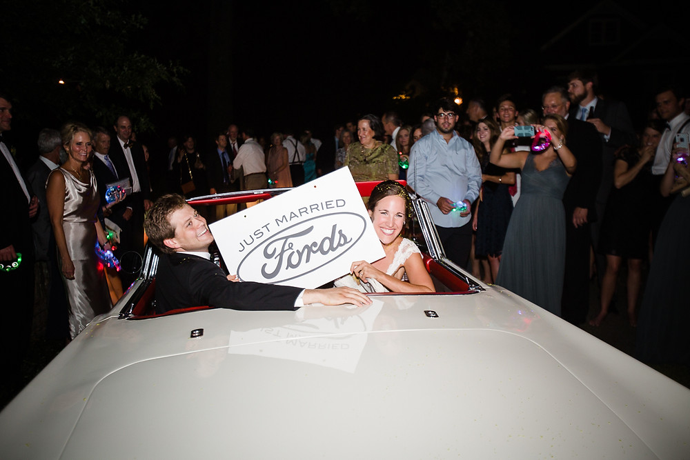 image of couple smiling with just married sign
