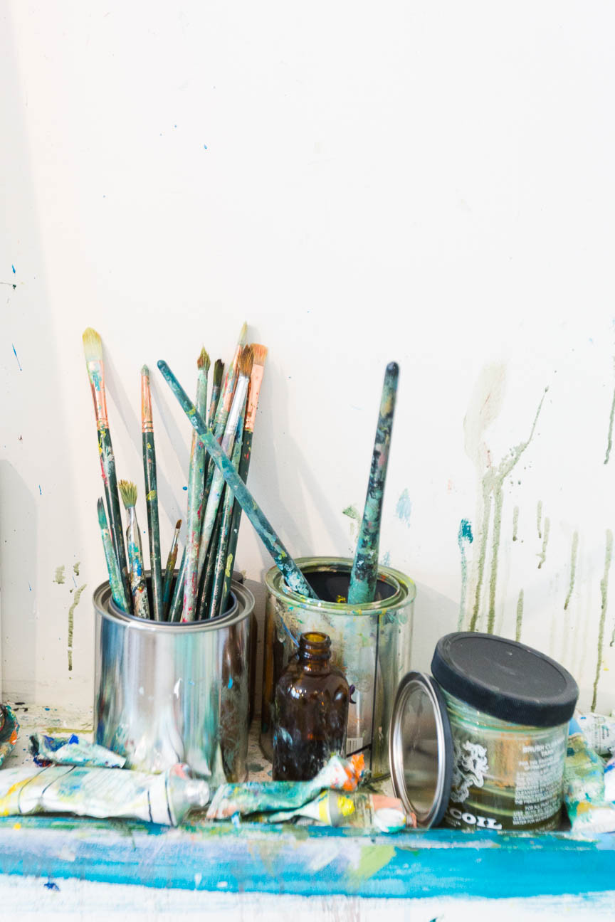 image of paint brushes in a can