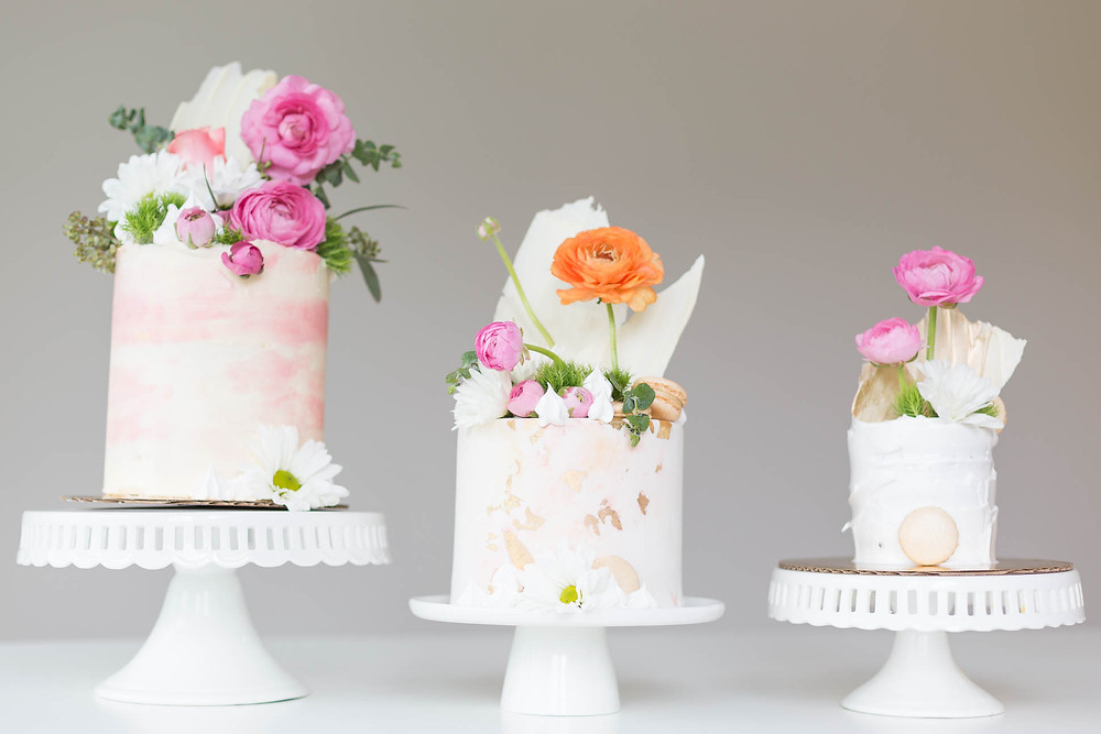 three mini wedding cakes with pink and orange florals, Greenville SC cake baker, wedding cake