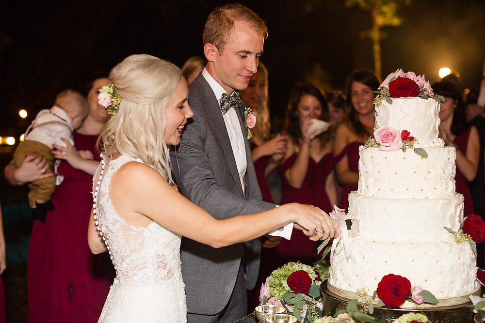 couple cuts their wedding cake