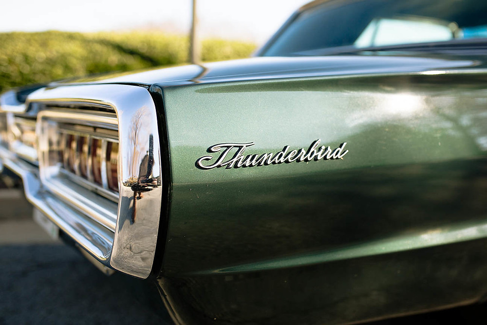 image of Thunderbird logo on vintage green car