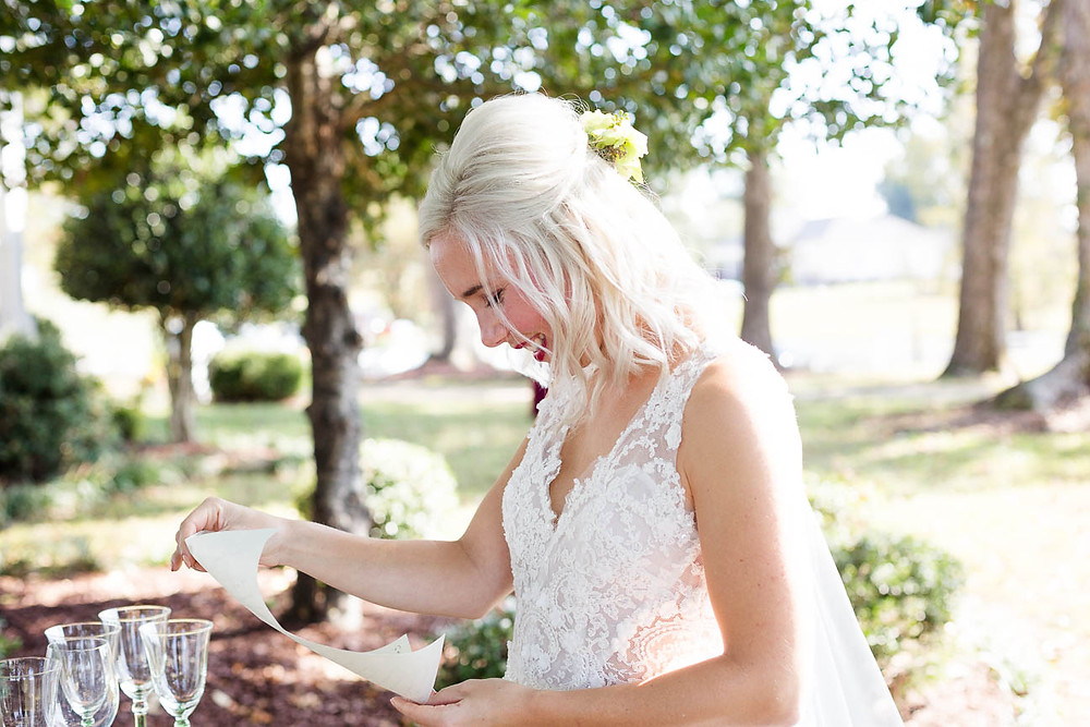 bride reads a love note from the groom