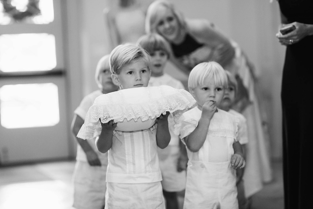 portrait of little ring bearers before walking down the aisle in a church ceremony