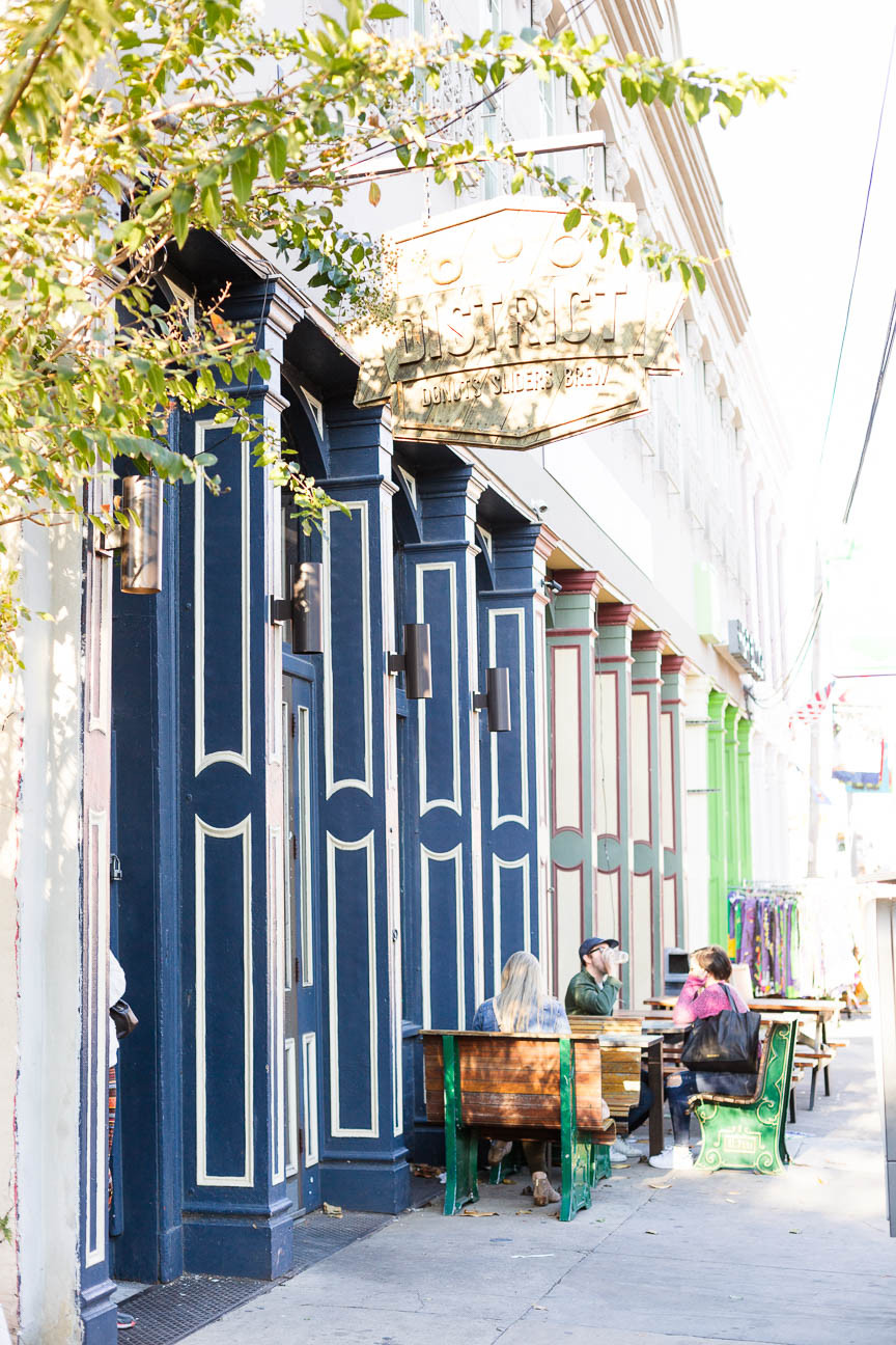 people sit outside of coffee shop in New Orleans