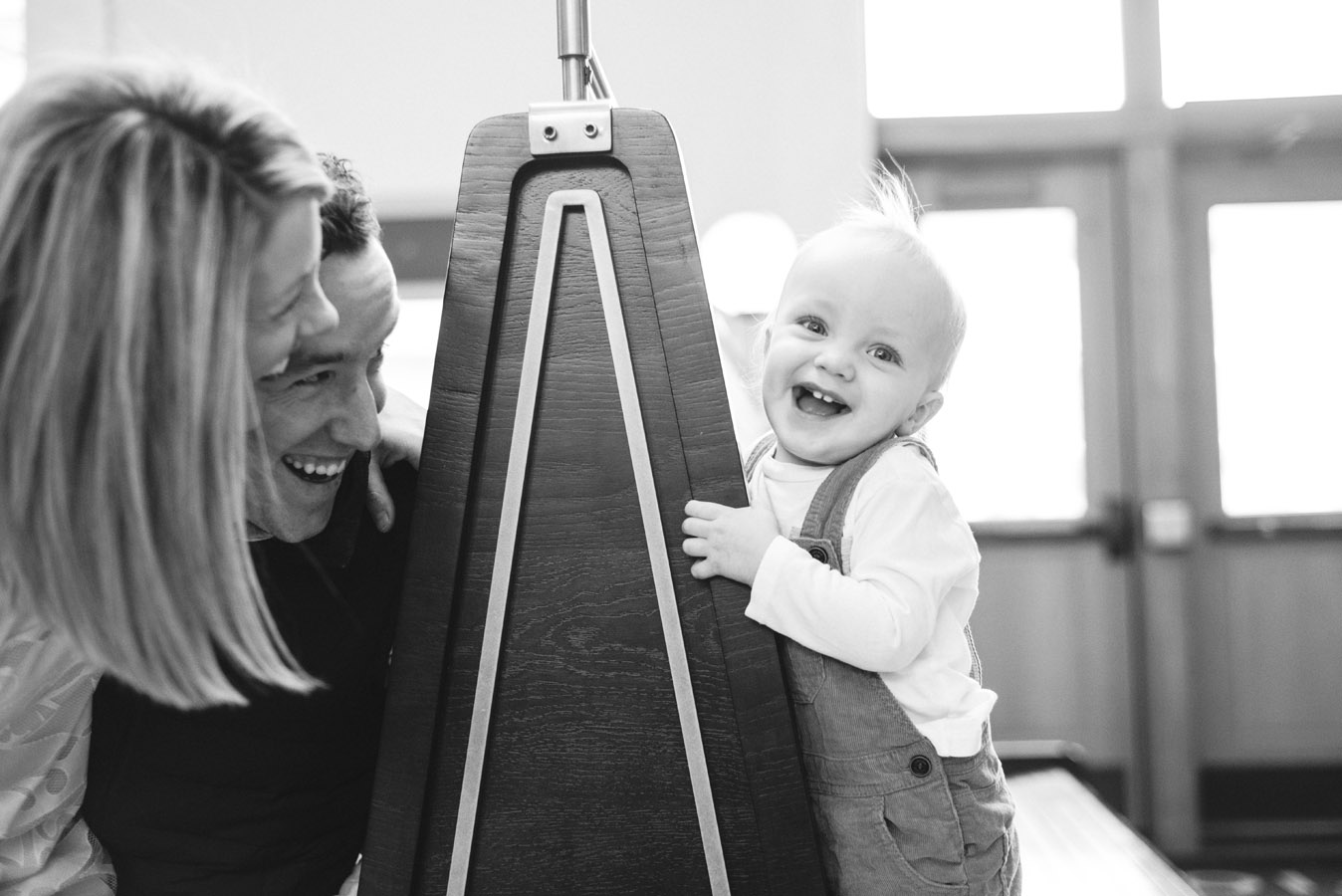 Family Laughs with Little Boy Image