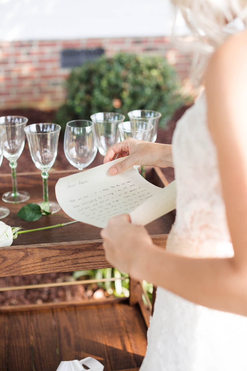 bride reads a note from her fiance on her wedding day