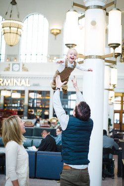 Dad throws Son into the Air Image