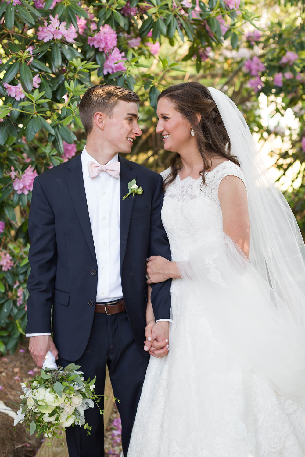 newlyweds look at each other after their outdoor mountain ceremony