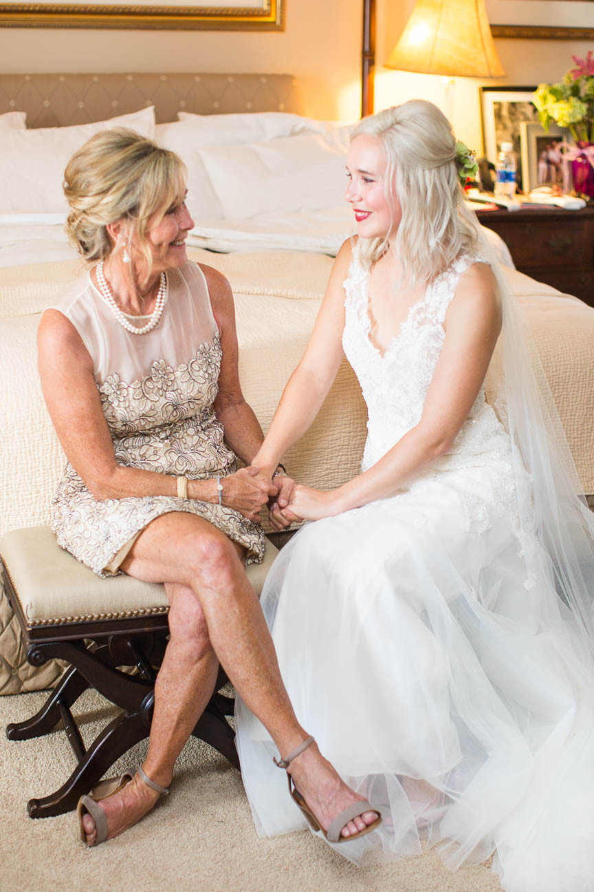 bride and her mother talk before the wedding ceremony