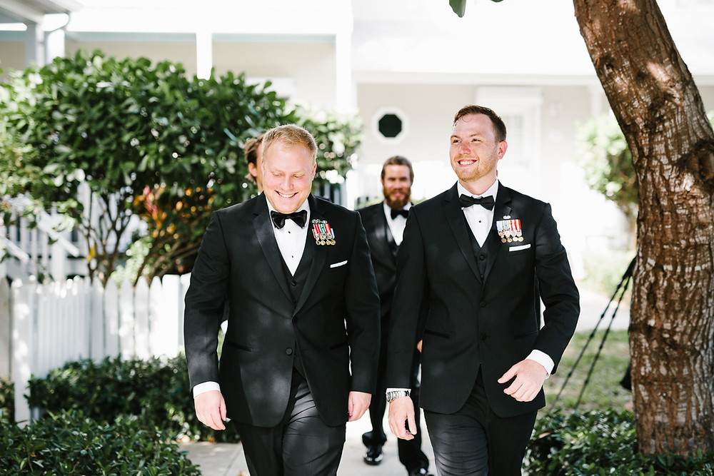 Groom and best man walk happily together, destination wedding, southern weddings, wedding photography