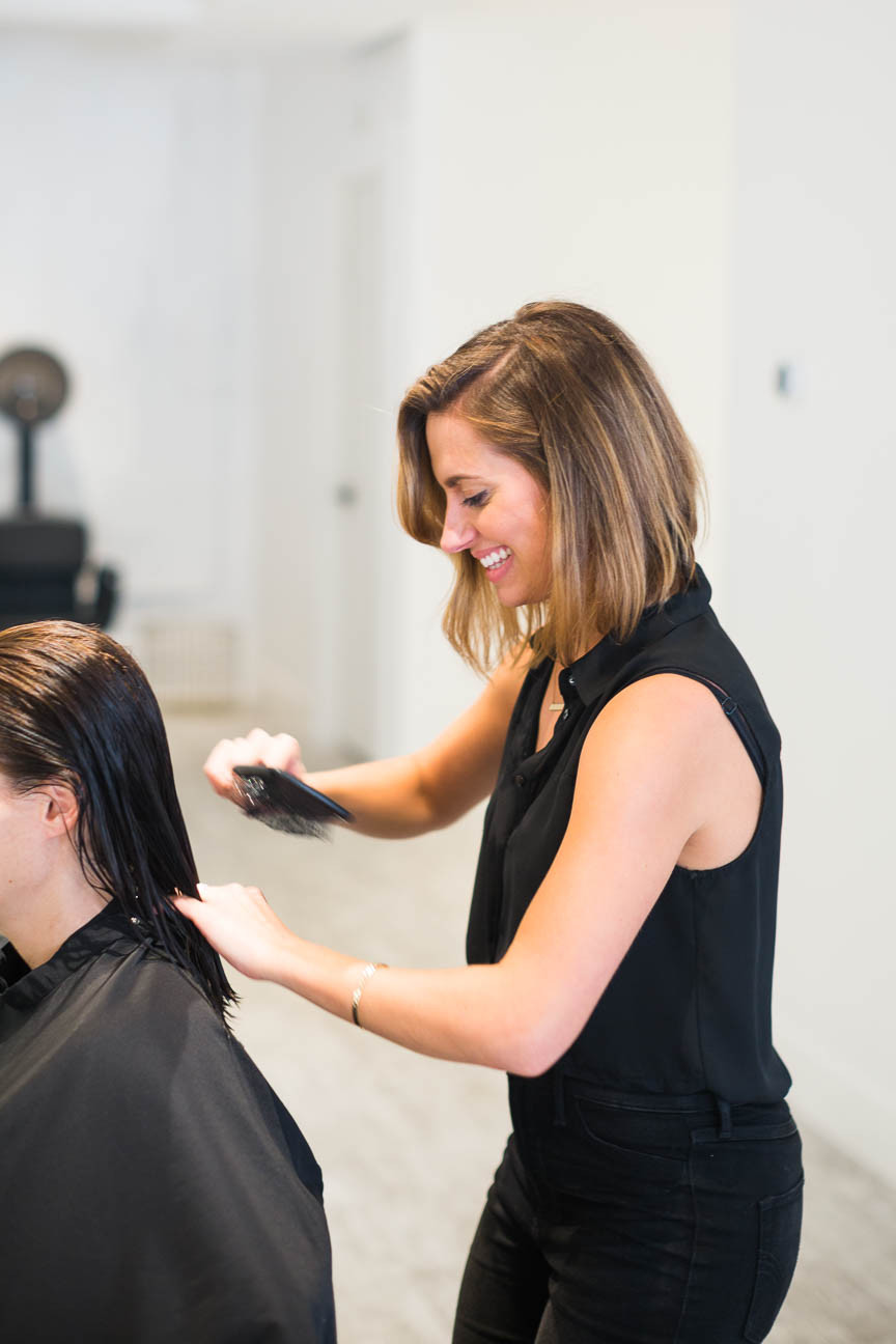 Kelsey cuts a client's hair at her salon in Greenville