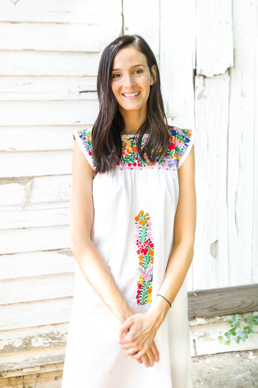 image of artist standing outside of her studio