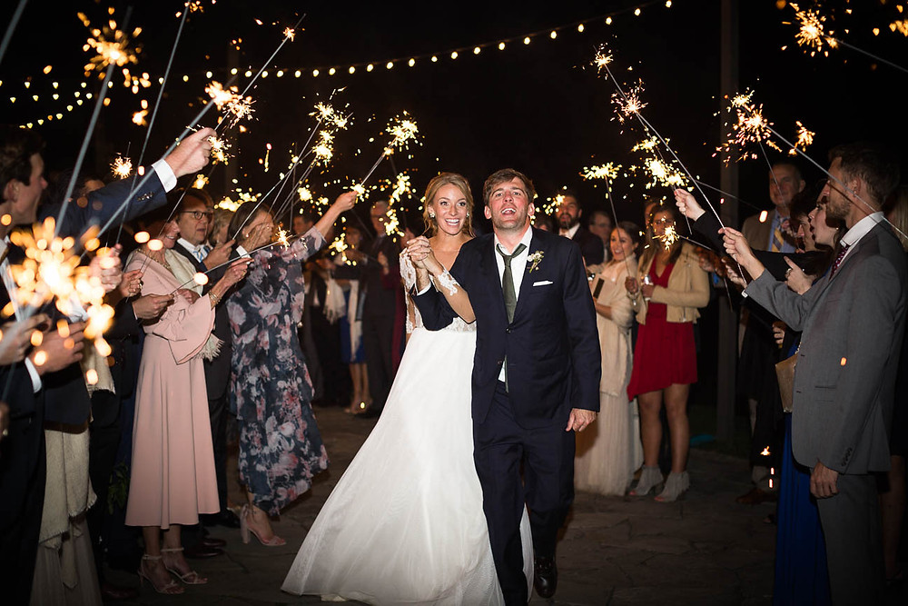 guests send off newlyweds with sparkler departure