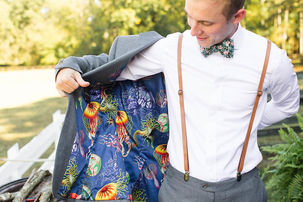 groom puts on his jacket