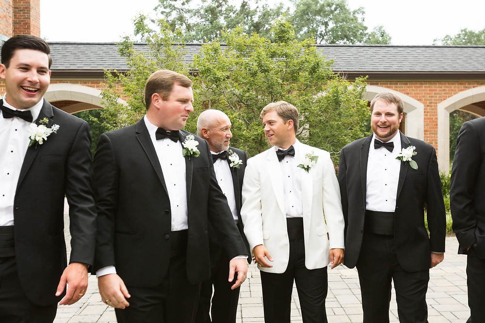 groom walks with his groomsmen on the wedding day in SC