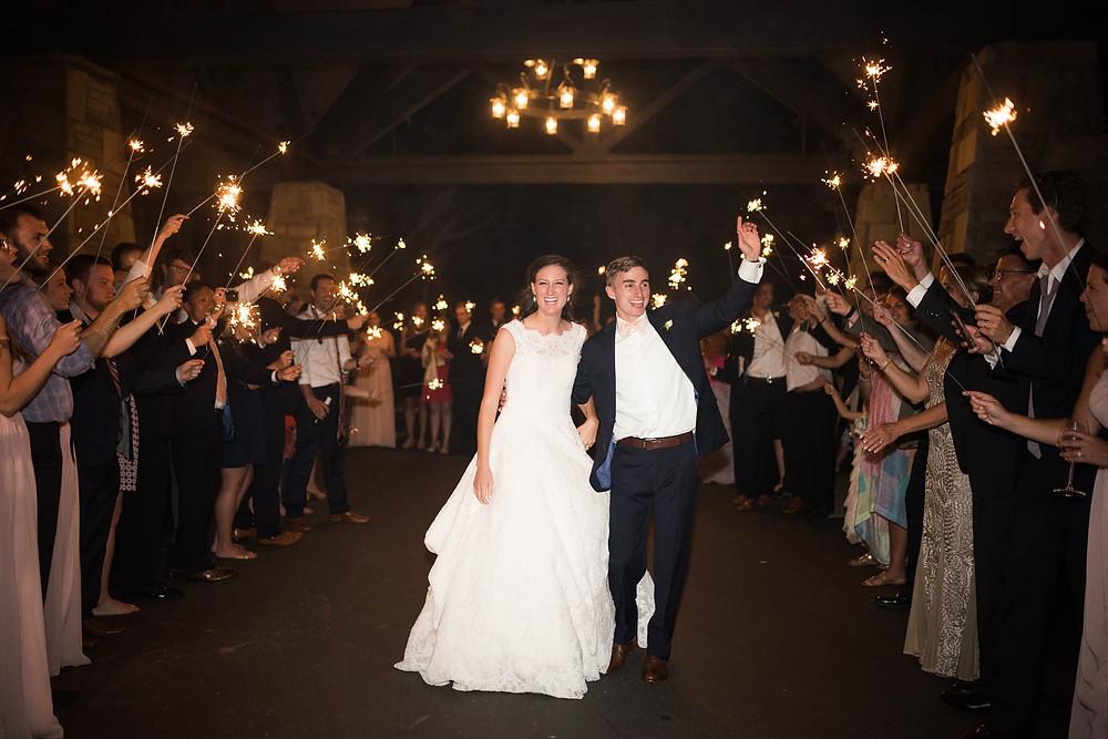 bride and groom wave during sparkler departure