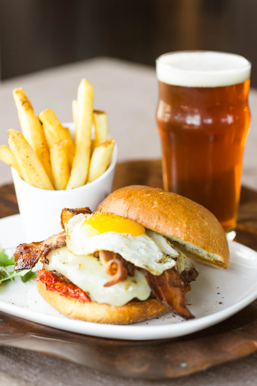 image of burger with fried egg, fried, and beer