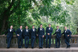 Groomsmen on bridge