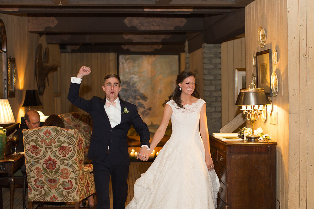 newlyweds enter their reception cheering