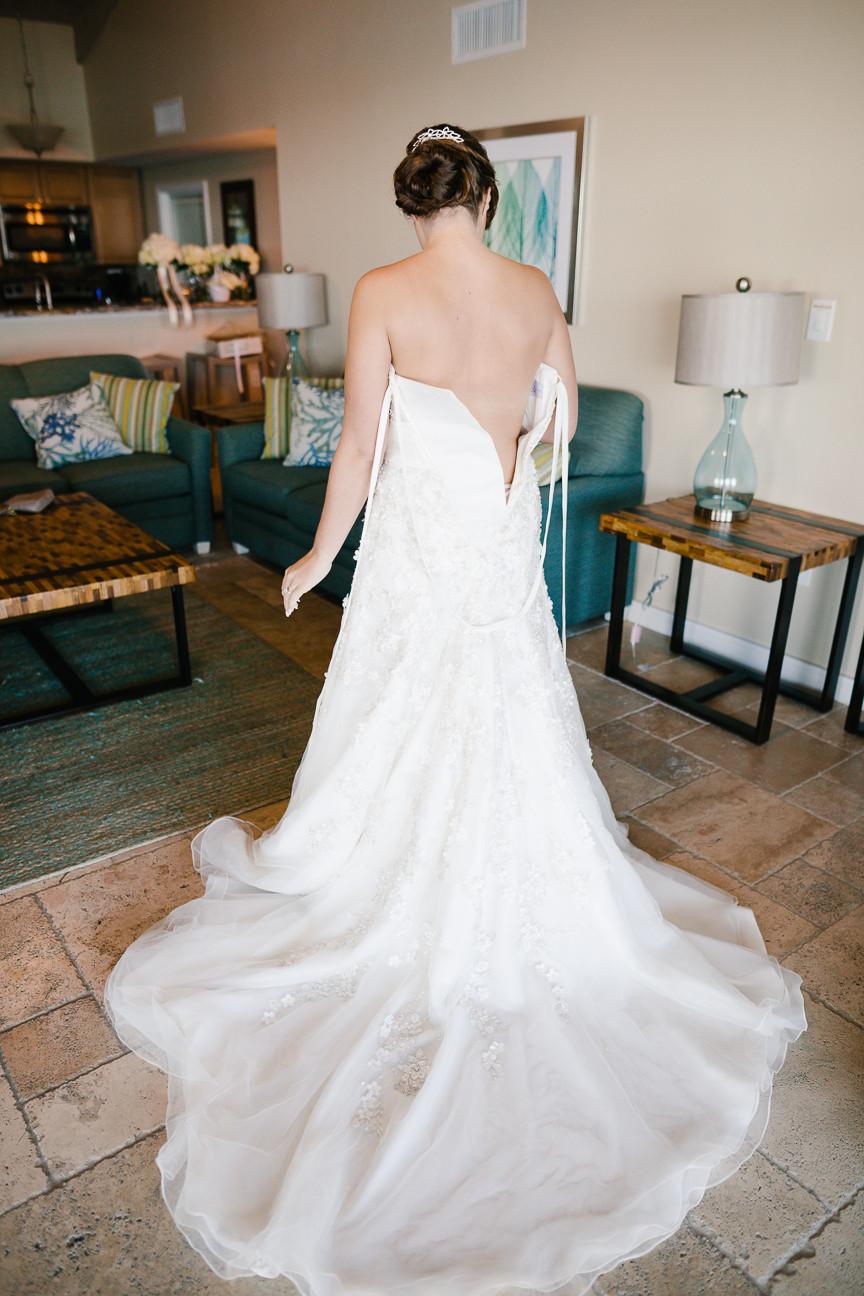 bride puts on her wedding dress, back shot, destination wedding, southern weddings, wedding photography