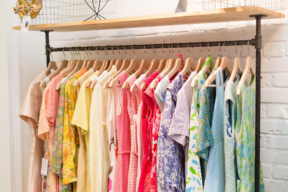 colorful vintage clothing on the rack at Kate DiNatale Vintage