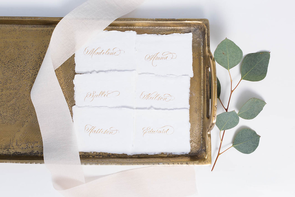 place cards on golden tray