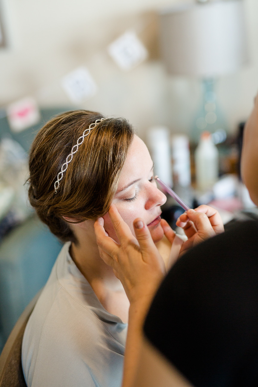 bride gets makeup done on wedding day, destination wedding, southern weddings, wedding photography