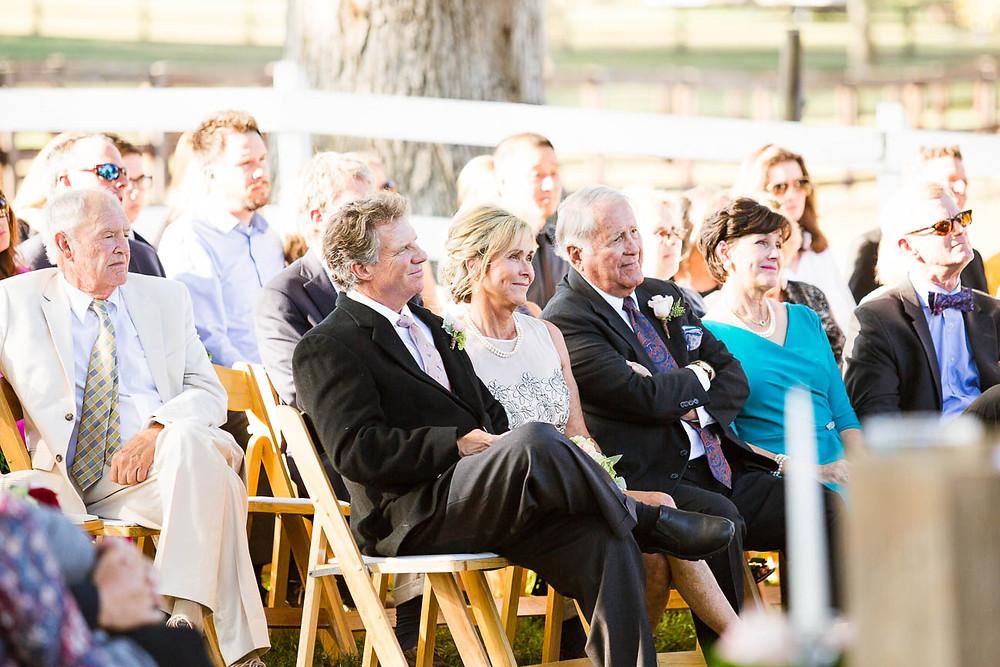 the couples family watches as the bride and groom say their vows