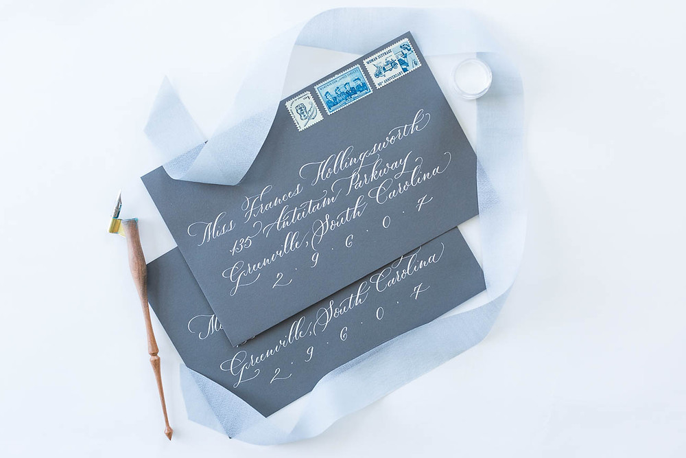 blue and grey invitation suite with hand lettering