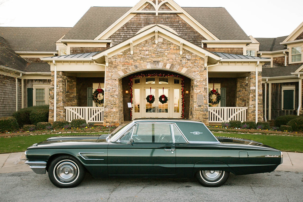 image of a vintage green Thunderbird outside a golf club in Hartwell, Georgia