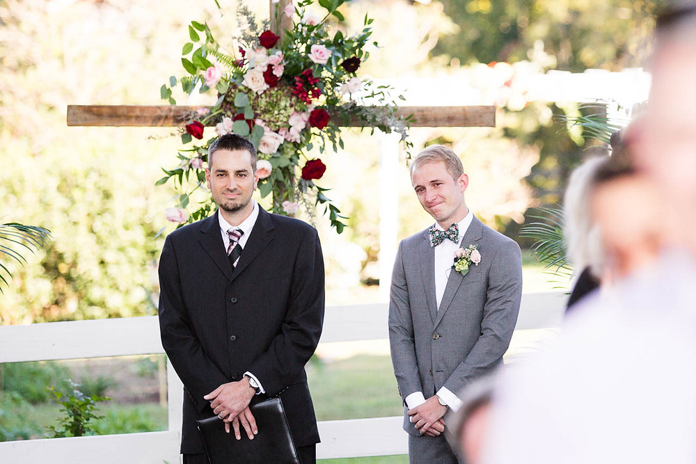 groom cries as he sees his bride for the first time walking down the ailse