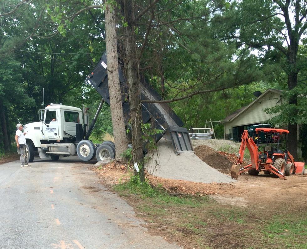 Spreading Gravel - Backhoe and Front End Loader