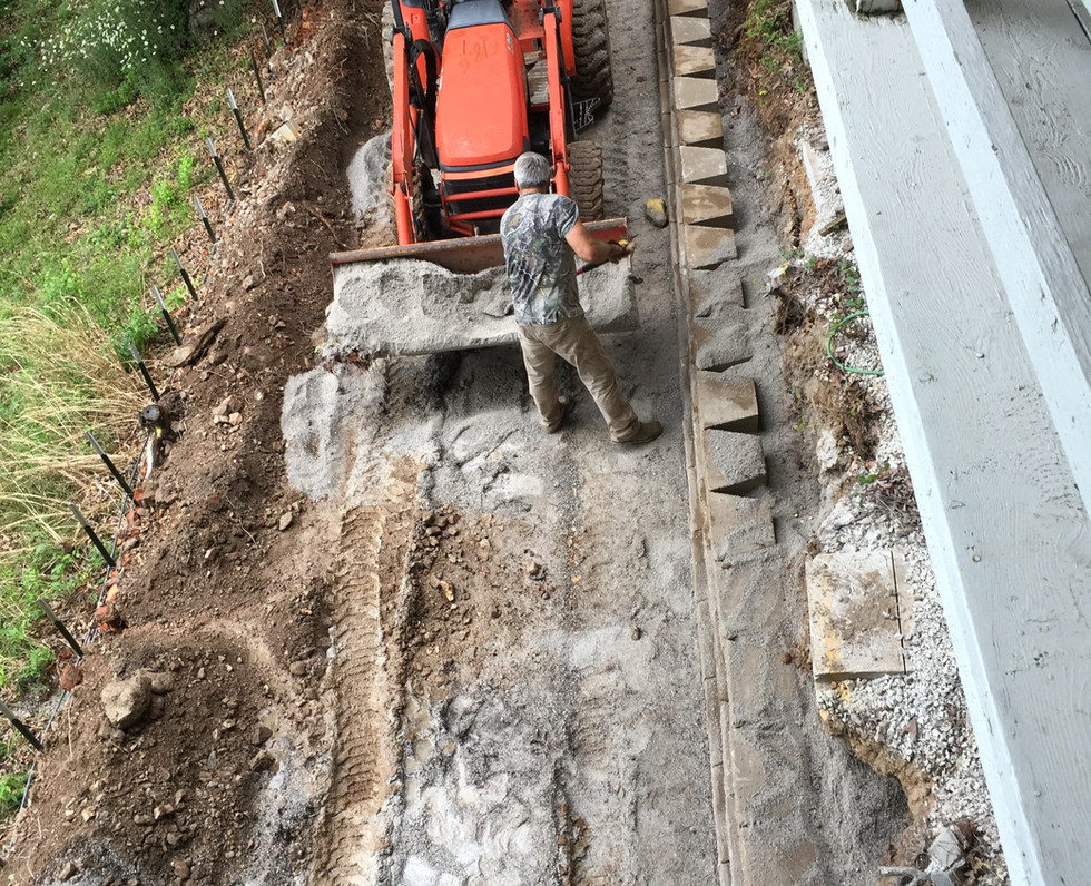 Driveway and retaining wall - front end loader