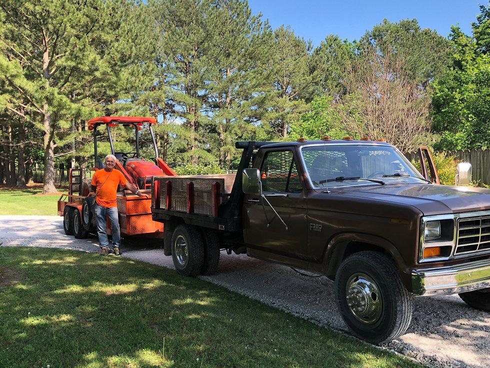 L39 Kubota tractor, front-end loader, box blade, backhoe, 3-yard dump truck