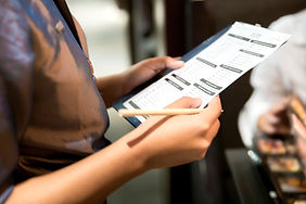 waitress-writing-a-food-order-531292661_