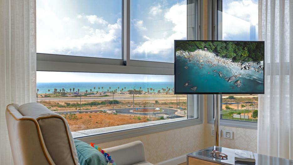 עיצוב חדר שינה עם נוף לים