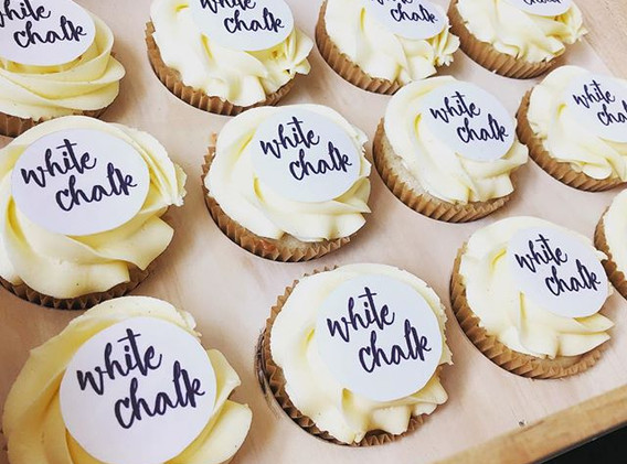 Classic white branded cupcakes as a surp