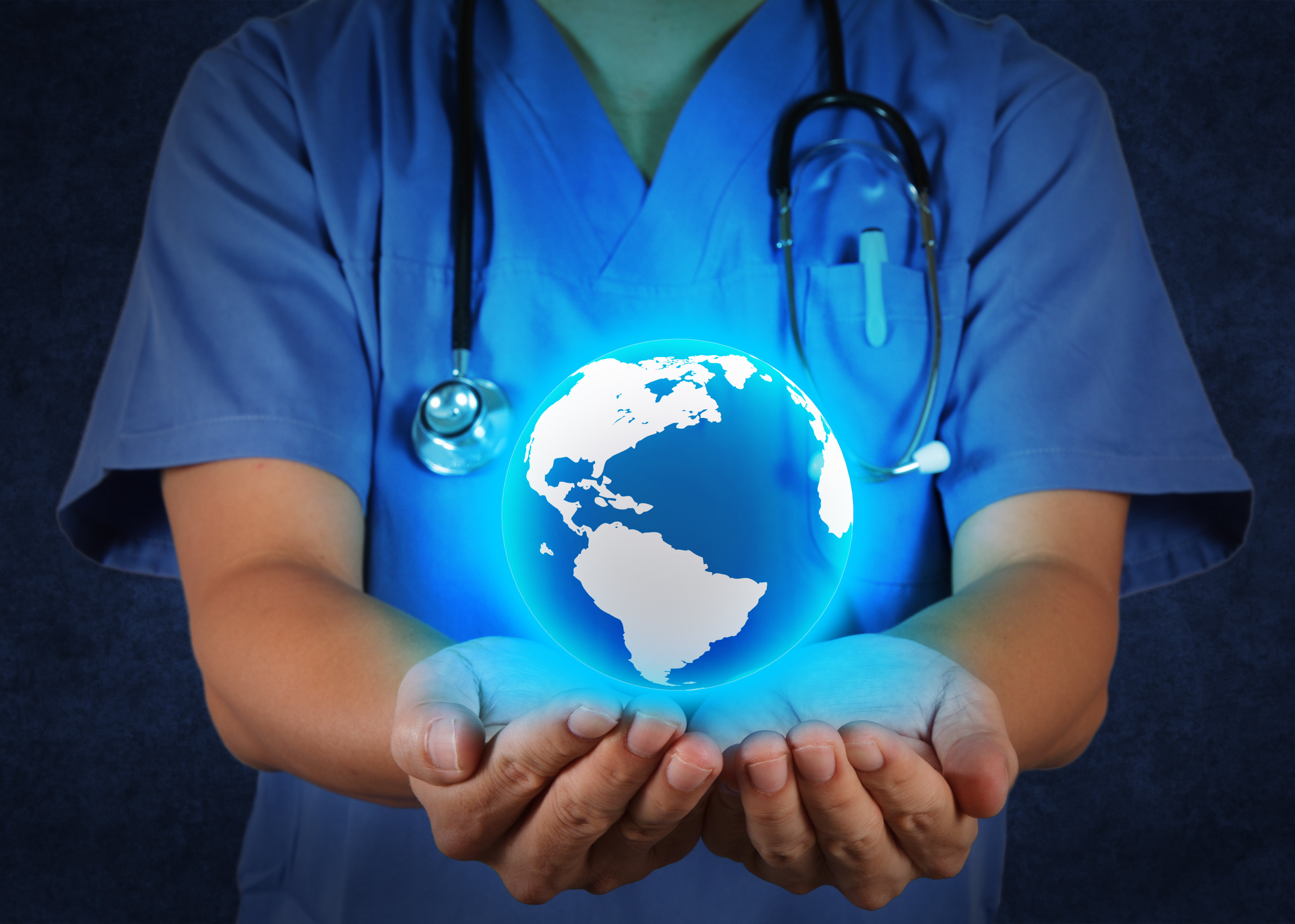 Medical Doctor holding a world globe in